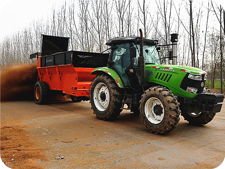 大型拖拉机带撒粪车